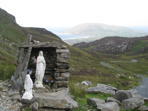 The centre of Mamore gap, looking down into Urris. The shrine is part of a larger structure that marks the location of St Eigne's Well, one of the famous Holy Wells of Ireland.