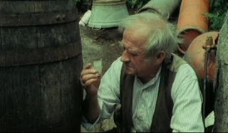 Cyril Cusack playing an illegal distiller in the  1977 film Poitin. The first film entirely done in Irish, it pulled no punches in showing the downsides of the illegal trade.