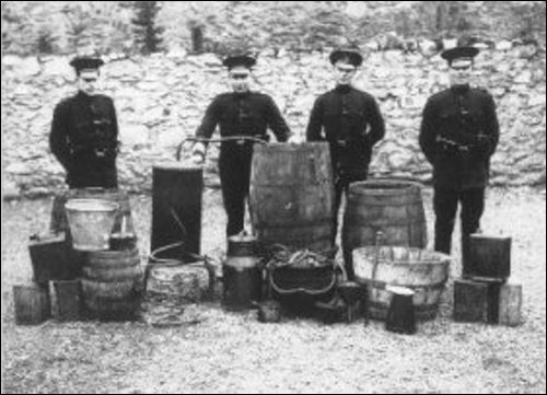 The police with a seized poitin still.