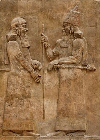 Sargon II, who named himself for the ancient Akkadian ruler, speaking to a dignitary.