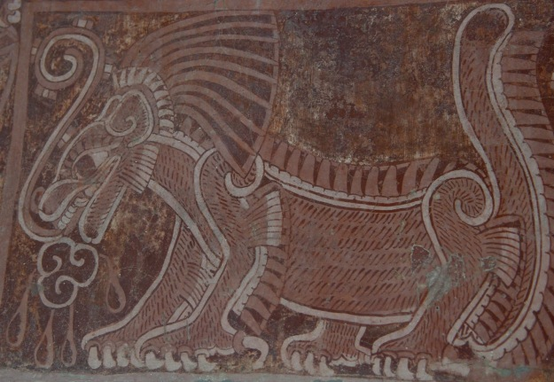 "A mural of the Netted Jaguar. The line coming from the mouth is a ""speech scroll"", indication that the jaguar is speaking. The marks on the scroll would indicate the tone of voice or type of speech."