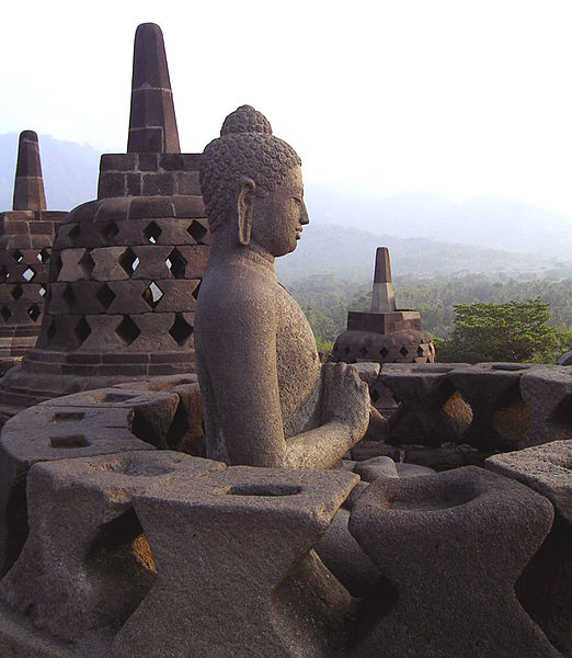A Buddha statue from Borobudur, with a hand position symbolizing the turning of the wheel of fate.