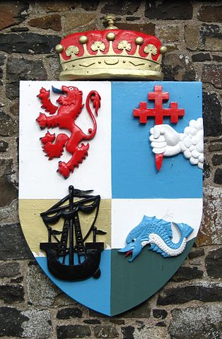 The arms of Clan MacDonnell of Antrim, displayed on Dunluce Castle. Photo by Adam Cuerdon, via Wikimedia Commons.
